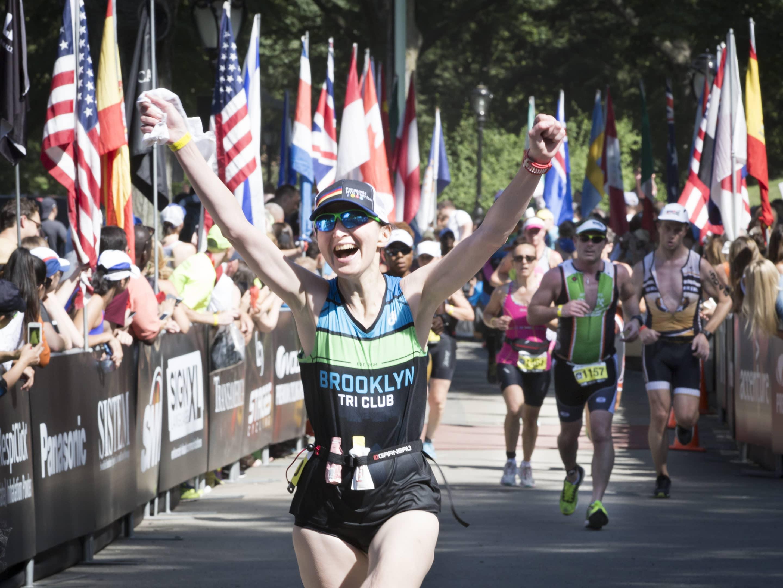 Female triathlete competing